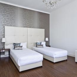 Adele Hotel - Lakosztály - ágyak